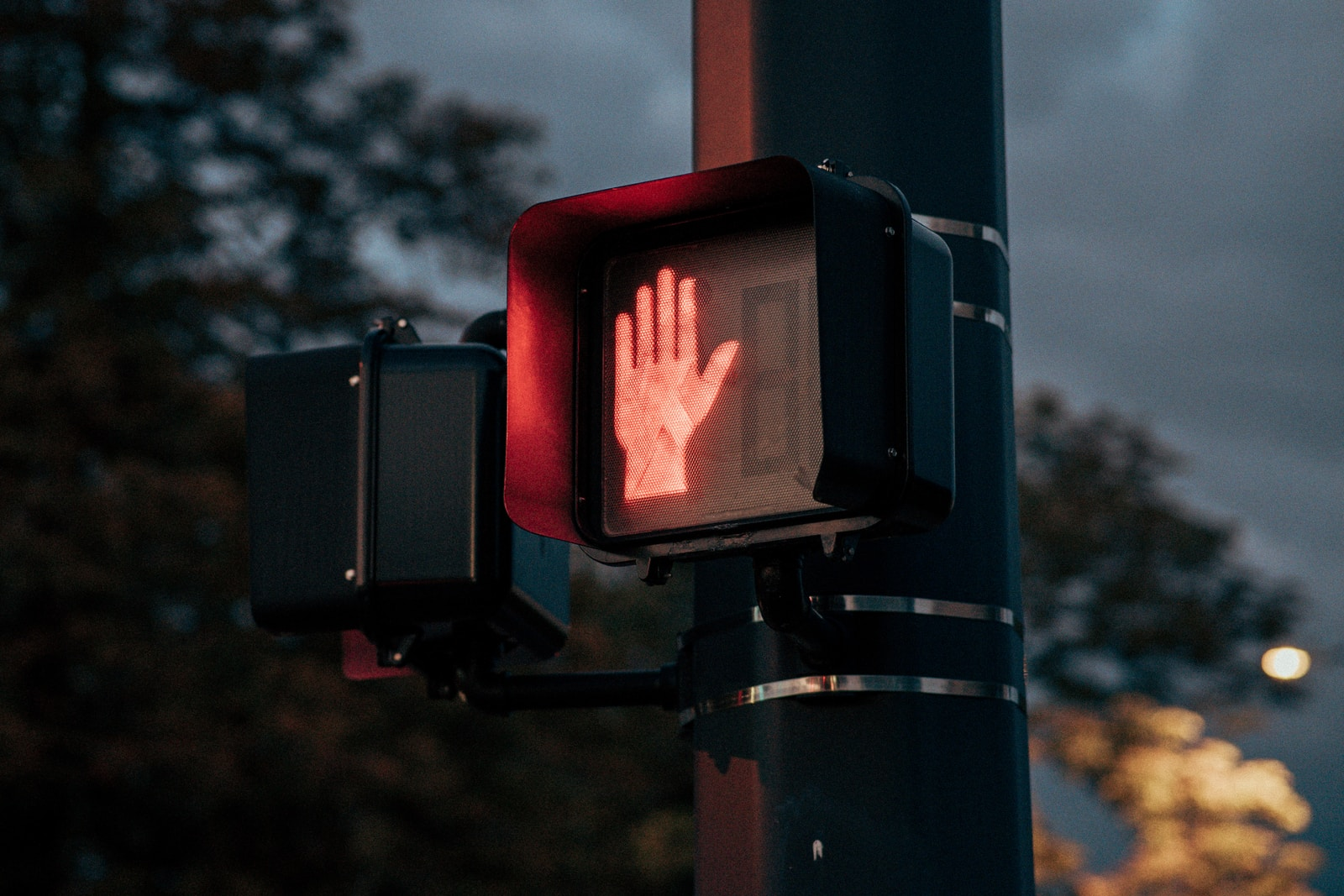 black traffic light with red light