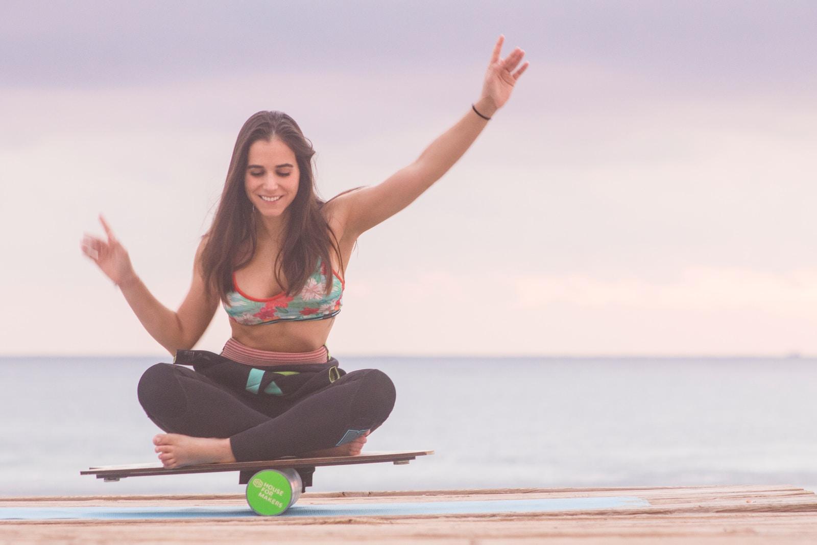 woman balancing on board